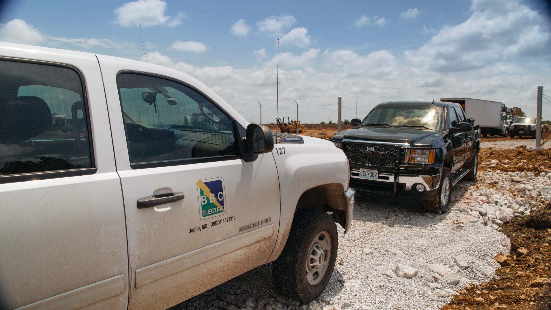 Image of multiple trucks at the Empire Substation construction site in Joplin, MO.