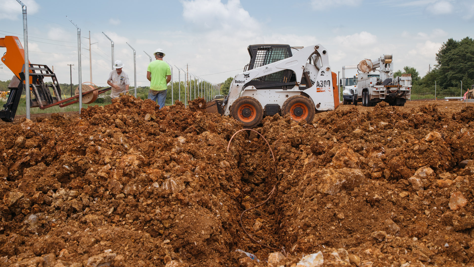 Image of small bulldozer moving dirt during the beginning stages of Empire Substation construction in Joplin, MO.