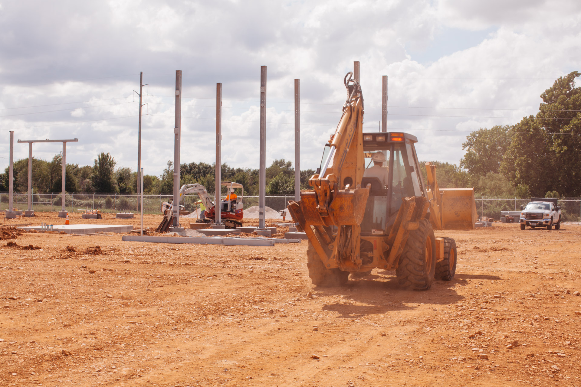 Image of backhoe moving toward Empire Substation construction site in Joplin, MO.